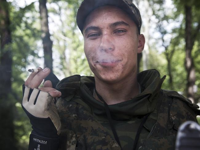 Smoking cigarettes and waiting ... the separatists are waiting for the Ukrainian troops. Picture: Ella Pellegrini
