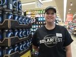 Safeway grocery store employee Misti Chiaffino stands next to a display of Ecliptic Brewery beer August 19, 2017 in Madras, Oregon. The town is preparing for the August 21 total solar eclipse that will be visible across the continental US. Picture: AFP PHOTO / STAN HONDA
