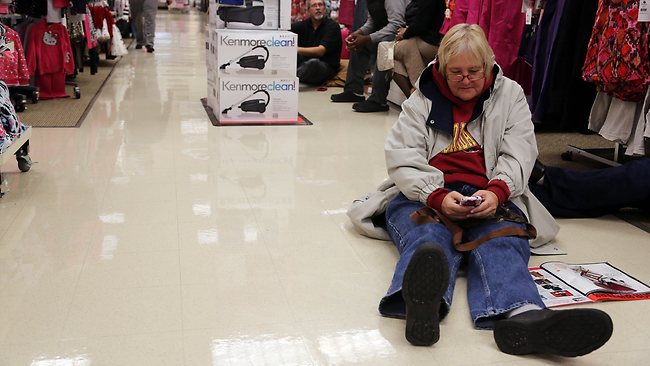 HOBART, IN - NOVEMBER 22: Shoppers came out early at Sears for the 4am doorbuster deals on Thanksgiving night November 22, 2012 in Highland, Indiana. Many stores got a head start on the traditional Black Friday sales by opening on Thanksgiving. Tasos Katopodis/Getty Images/AFP== FOR NEWSPAPERS, INTERNET, TELCOS & TELEVISION USE ONLY ==