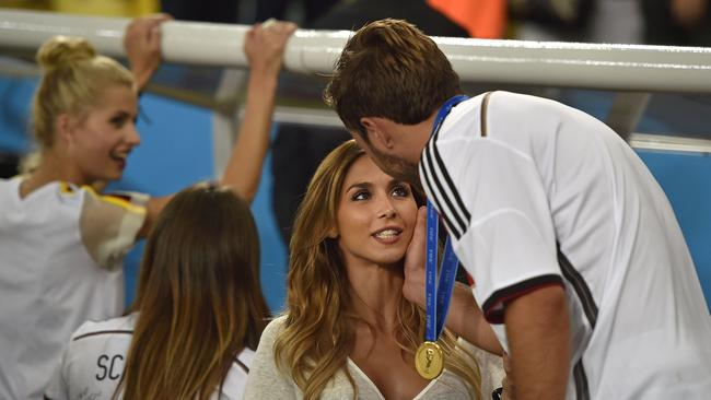 Golden moment: Mario greets his girlfriend Ann-Kathrin Broemmel after the World Cup final.