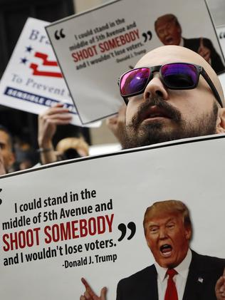 Anti-gun violence protesters stage a die-in in front of Trump tower following recent inflammatory comments from him. Picture: AP Photo/Mark Lennihan.