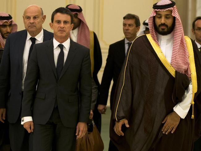 Well known ... French Prime Minister Manuel Valls (C-L) and Saudi Defence Minister Mohammed bin Salman bin Abdul Aziz (C-R). Picture: AFP