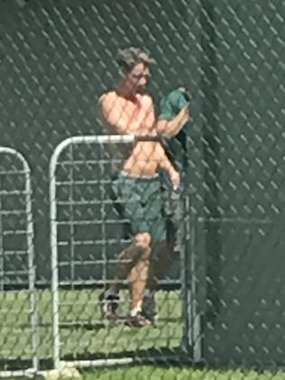 A shirtless Curtis in Cooma prison.