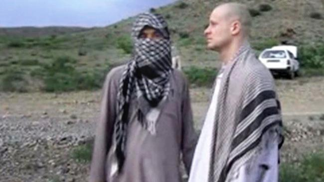 The handover .. Sgt Bowe Bergdahl, right, stands with a Taliban fighter in eastern Afghanistan. Picture: Voice Of Jihad Website via AP video