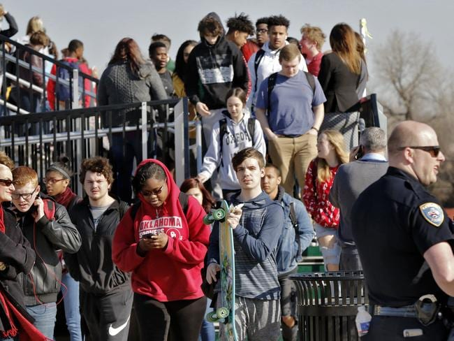 Several hundred Edmond Santa Fe High School students in Oklahoma chose to participate in a symbolic 17-minute walkout. Picture: Jim Beckel