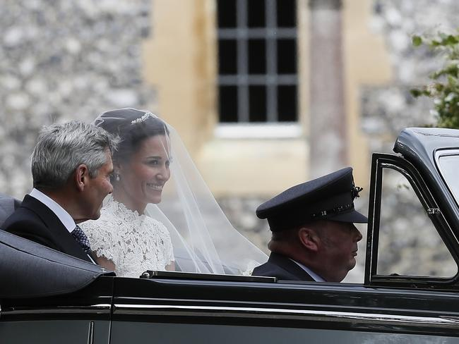 Pippa Middleton rides with her father Michael Middleton. Picture: AP