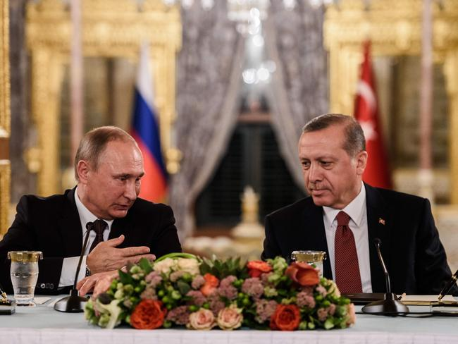Russian President Vladimir Putin (left) at a press conference in Istanbul with Turkish President Recep Tayyip Erdogan (right) on October 10, 2016. Picture: AFP/Ozan Kose