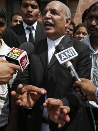 Defence lawyer V. K Anand says his client will appeal his sentence as he comes out of an Indian court after a judge convicted four men in the fatal gang rape of a young woman on a bus in New Delhi. (AP Photo/Saurabh Das)
