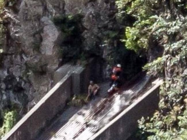 The man was stranded on a steep and slippery aqueduct. Picture: NZCC Rescue Helicopter