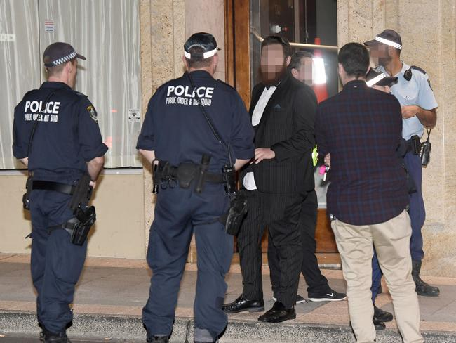 Police speak to witnesses following a brawl outside the reception venue in Leichhardt.