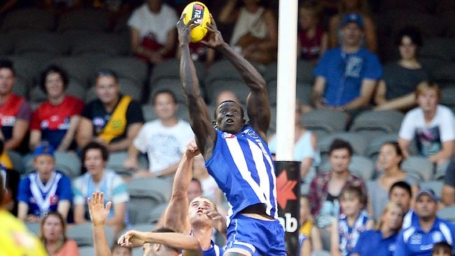 North Melbourne ruckman Majak Daw provided the first highlight of the match with a strong mark backing into a pack. Picture: Wayne Ludbey