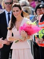 Catherine, Duchess of Cambridge receives flowers from spectators at the Playford Civic Centre. Picture: Getty