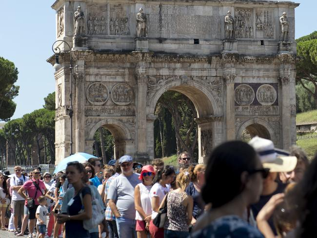 Rome, Italy - July 28, 2015: Visitors wait in the ticket queue for Colosseum during a hot summer day.