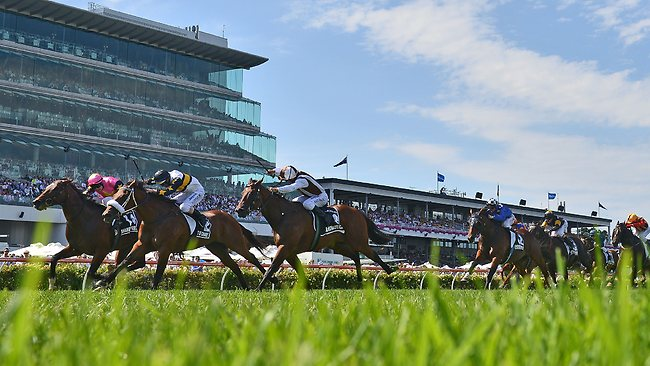Craig Newitt and Shamexpress (left) gain the upper hand in the closing stages of the Newmarket Handicap at Flemington.