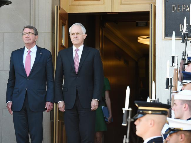 Prime Minister Malcolm Turnbull with former US Defense Secretary Ash Carter during a Pentagon Honour Cordon in Washington DC. Picture: Jake Nowakowski.
