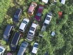 An aerial photograph of abandoned vehicles. They can't be removed until the owners give their consent. In the background the hills to which the schoolchildren escaped. Fukushima, Japan. Picture: Arkadiusz Podniesinski/REX Shutterstock/australscope