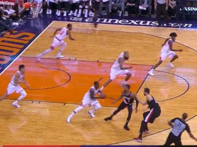 Five Phoenix Suns players ran in-sync.