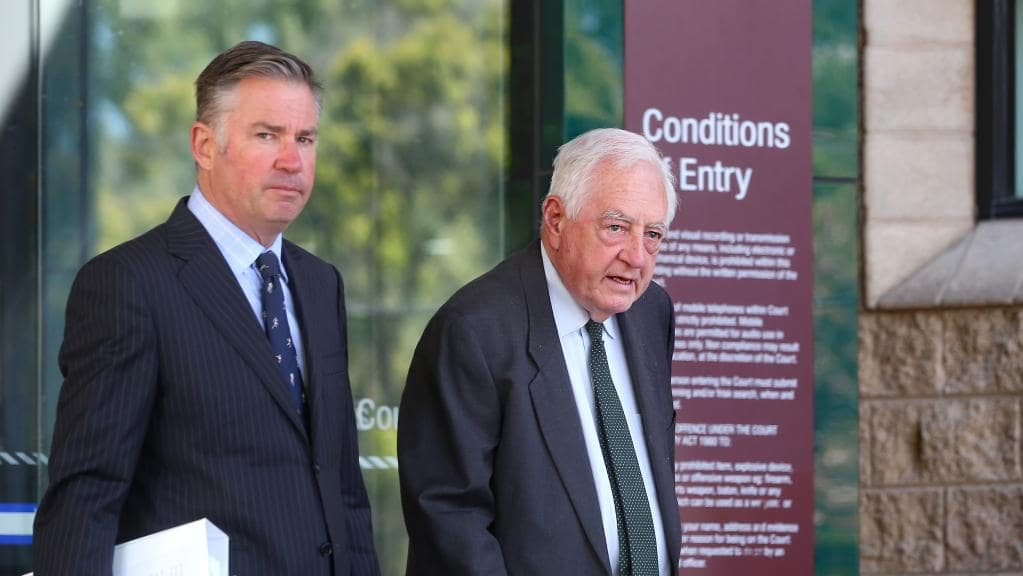 Former Geelong Grammar Doctor David Mackie (right) leaves Geelong Magistrates' Court.