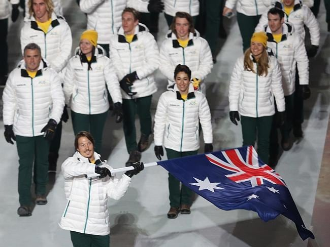 Snowboarder Alex Pullin carries the flag for the Australian Olympic during the Opening Ceremony of the Sochi 2014 Winter Olympics. Picture: Getty