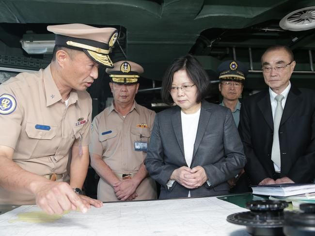 Taiwan's President Tsai Ing-wen, centre right, reviews nautical charts aboard a Taiwan Navy ship before it sets out to patrol in the South China Sea from the naval base in the southern port city of Khaohsiung, Taiwan.