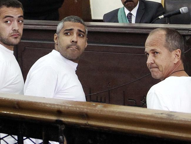 Al-Jazeera English producer Baher Mohamed (from left), Canadian-Egyptian acting Cairo bureau chief Mohammed Fahmy and Peter Greste in court.