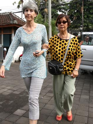 Still hoping ... Andrew Chan's mother Helen accompanied by Australian Consul in Bali, Majell Hind, makes her daily visit to see him inside Kerobokan jail. Picture: Lukman S Bintoro