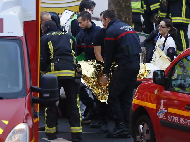 Rescue service workers and firefighters tend to injured people in the second Paris shooting. Picture: Thomas Samson