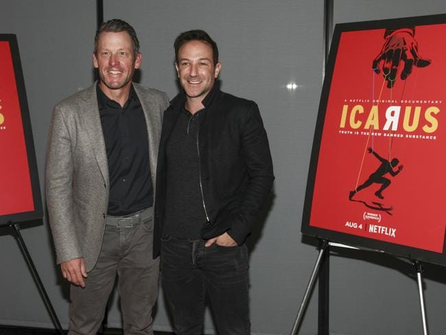 Lance Armstrong, left, and Bryan Fogel, attend a special screening of Netflix's documentary Icarus, which explores doping in cycling. Picture: Andy Kropa/Invision/AP