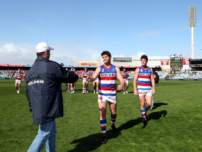 Brothers Chris and James Gowans walk off after retiring from SANFL footy in 2012.