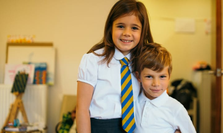 How to help your child when their older sibling starts school
