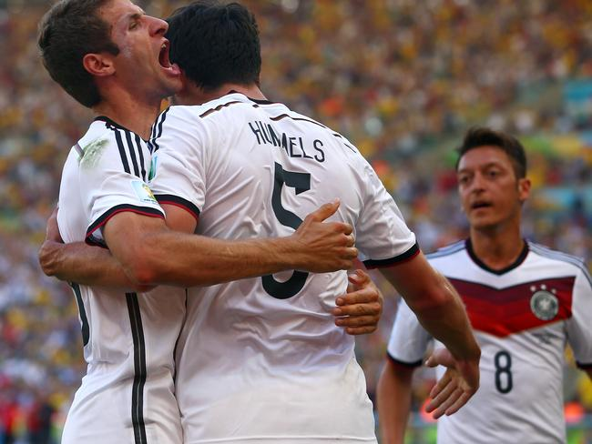Mats Hummels of Germany (middle) celebrates scoring against France with Thomas Mueller (left).