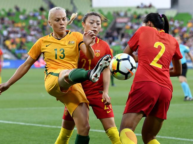 Tameka Butt is a hotly contested battle for the ball against China.