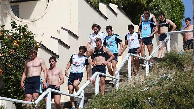 The NSW Waratahs players are put through a fitness session running the Denning Street stairs in Coogee. Picture: Phil Hillyard