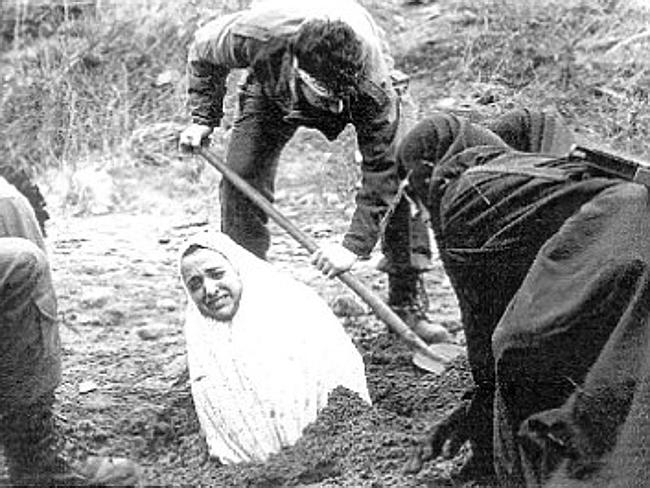 A 1990s Amnesty International image of a woman being buried before she was stoned to death in Iran. The punishment has been written into the country's penal code since the Islamic Revolution in 1979.