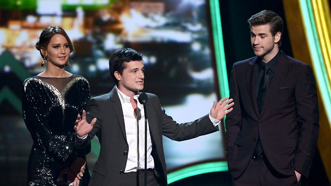 Actors Jennifer Lawrence, Josh Hutcherson, and Liam Hemsworth accept the Favorite Movie award onstage at the 39th Annual People's Choice Awards. Picture: Getty