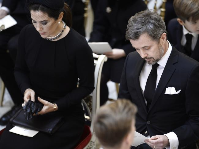 Crown Princess Mary and Crown Prince Frederik of Denmark attend the funeral for Prince Henrik in Copenhagen. Picture: AP