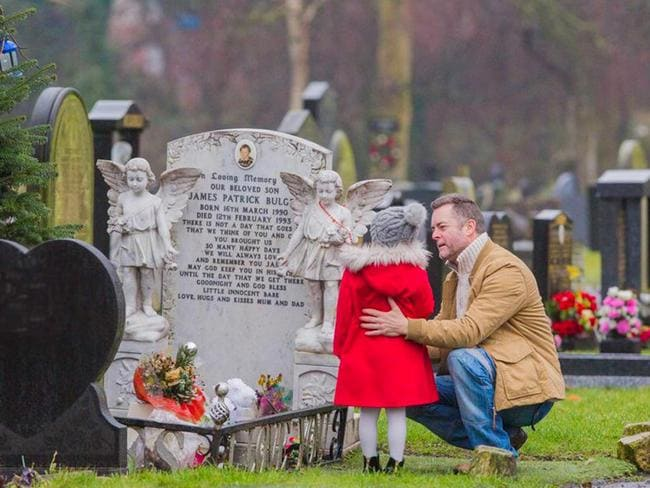 This is the heartbreaking moment James Bulger's four-year-old sister visits his grave for first time with father Ralph Bulger. Picture: Mirrorpix