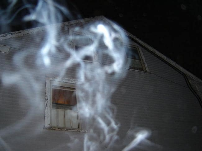 A ghostly apparition is caught on camera outside the Borden house.