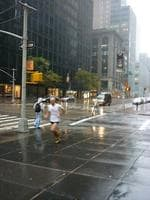 <p>A man powers through with his jogging routine along New York's storm-stricken streets. Picture: Sean Plambeck</p>