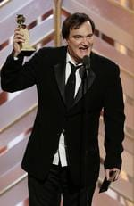 "Quentin Tarantino accepts the award for Best Original Score - Motion Picture for ""The Hateful Eight"" during the 73rd Annual Golden Globe Awards at The Beverly Hilton Hotel on January 10, 2016 in Beverly Hills, California. (Photo by Paul Drinkwater/NBCUniversal via Getty Images)"