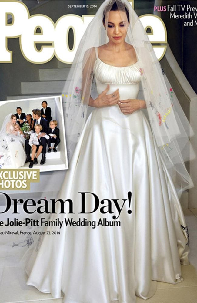 Stunning bride ... Angelina Jolie in her dress partly created by her kids. Picture: People