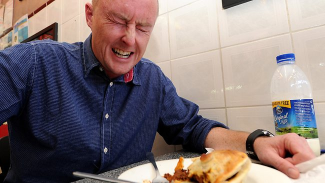 The battle: The Daily Telegraph journalist Richard Noone tackles the world's hottest pie. Picture: Peter Lorimer