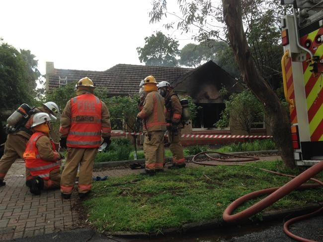 Firefighters at Hawke Street, Linden Park, where a blaze caused $250,000 damage to a home. Picture: Sam Wundke