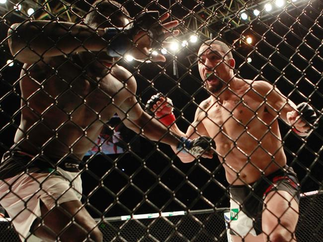 Robert Whittaker of Australia (R) defeats Derek Brunson. Picture: David Crosling