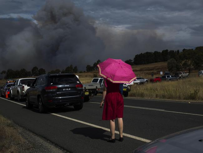 Genevieve Devin watches plumes of smoke as a fire approaches Hoskinstown.