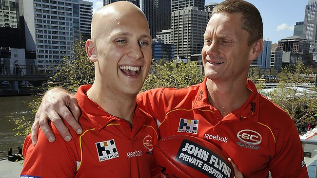 Gary Ablett Jr and Guy McKenna after signing with the Suns.