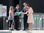 Prince William and his wife Kate at the Nothern Sound System, Elizabeth in Adelaide. Playford Mayor Glenn Docherty gifts a skateboard with the name George written on it to Kate and William for their son George. Picture: Tricia Watkinson.