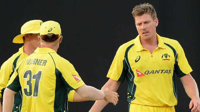 Australia's James Faulkner (R) celebrates with his teammates after he dismissed Sri Lanka's Thisara Perera (L) during the second one-day International (ODI) cricket match between Sri Lanka and Australia at The R Premadasa International Cricket Stadium in Colombo on August 24, 2016. / AFP PHOTO / LAKRUWAN WANNIARACHCHI