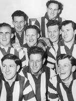 Aylett (bottom right) with first-year Kangaroos and veteran full-back Jock McCorkell in 1952. Also pictured are (from left, back): Peter Hamilton and Jack O'Halloran, (centre) John Brady, McCorkell, Kevin Easton and Mick Grameau, (front) Noel Alford, Laurie Icke and Allen Aylett.