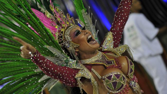 A reveller of Mangueira samba school performs during the second night of carnival parade at the Sambadrome in Rio de Janeiro, early on February 21, 2012. AFP PHOTO / CHRISTOPHE SIMON